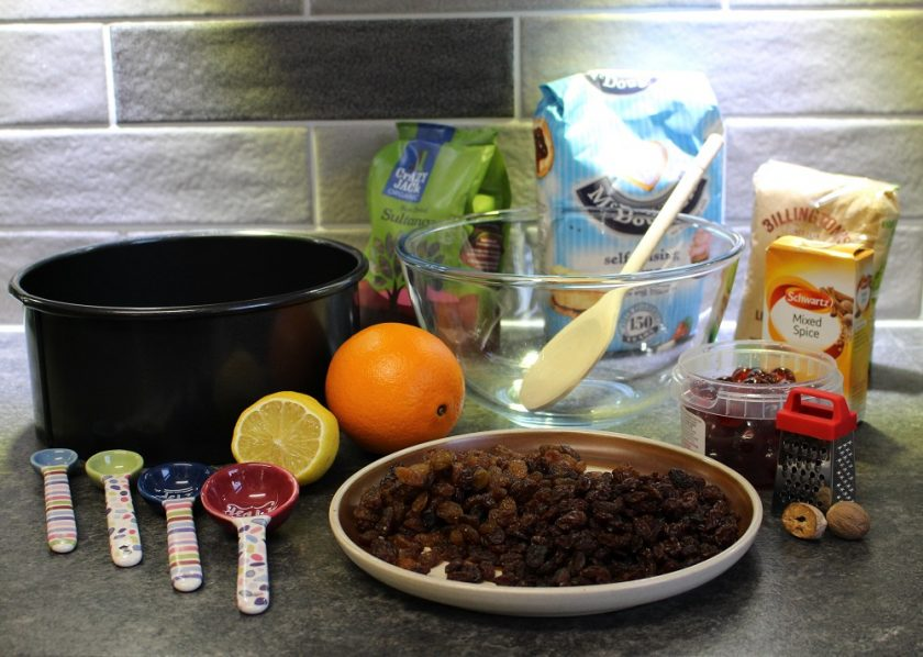 Christmas at Debenhams - Christmas cake making, cake tin, measuring spoons, lemon, orange, mixing bowl and dried fruit