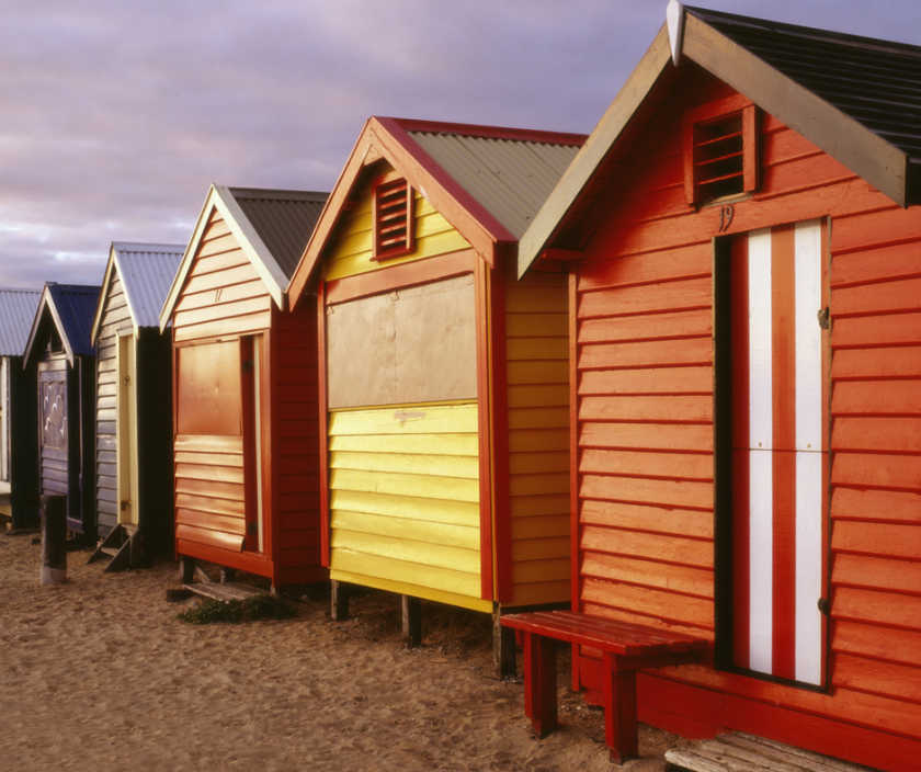 row of beach huts in different colours